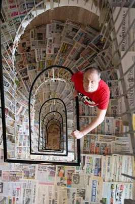 Collector With 1,444 Different Newspapers Earns Guinness Record